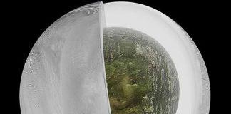 Ilustración del interior de Encelado, con una coraza de hielo, un corazón rocoso y un océano subterráneo en el polo sur