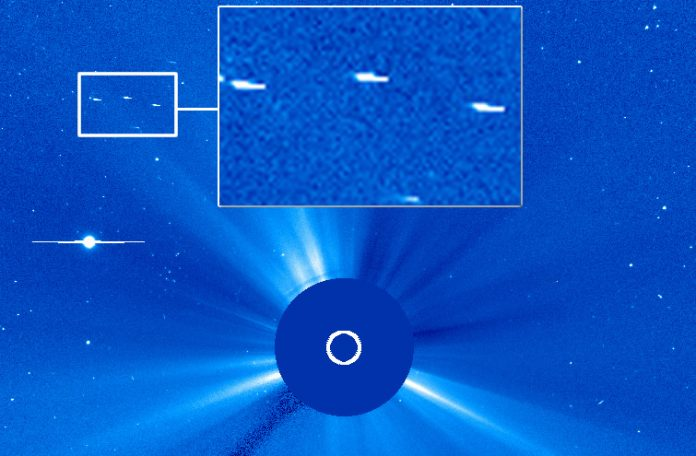 Fotografía del Sol tomada por SOHO muestra tres posibles objetos anómalos.